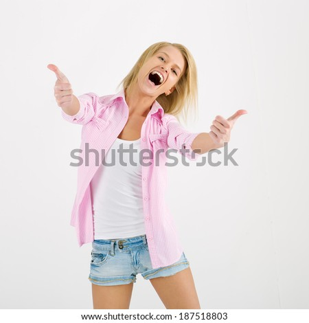 Young woman showing thumbs up. - stock photo