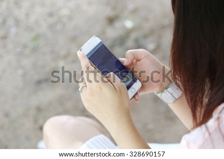 young women hand hold phone - stock photo