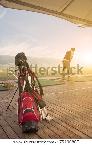 youth practicing golf - stock photo