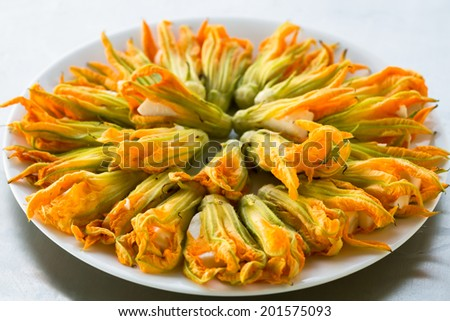Zucchini flowers stuffed with cheese prepared to fry  - stock photo