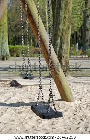 A abandoned seesaw on a playground. Sad impression... - stock photo