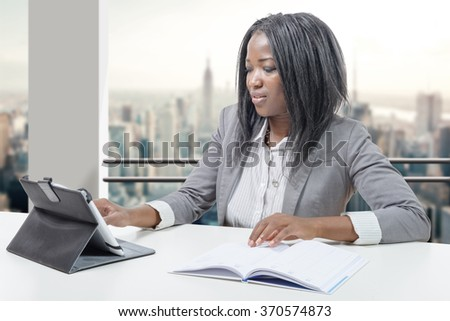 a african american business woman working with tablet - stock photo