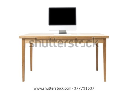 A aluminum(grey) desktop personal computer(PC) with wireless keyboard, mouse on the wood table(desk) isolated white. - stock photo