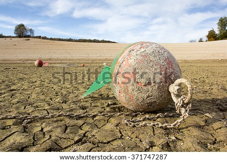 a anchor buoy on a dry lake - stock photo