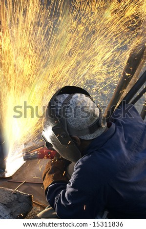 a arc welder busy at work - stock photo