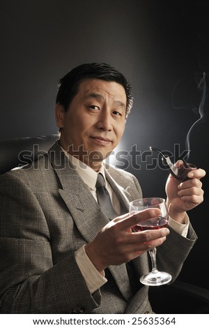 A Asia businessman Confidence smiling and smoking - stock photo