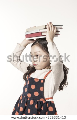 A asian(japan, chinese, korea) pretty girl hold a book on the head and reading, thinking hard, have a questions with a worry isolated white at the studio. - stock photo