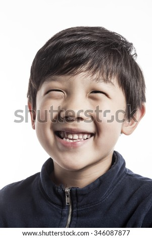 A asian(korean, japanese, chinese) boy(kid, student, child, man, male) make a portrait with a smile isolated white. - stock photo