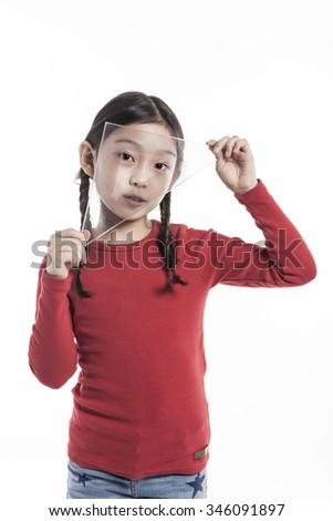 A asian(korean, japanese, chinese) girl(kid, student, child, woman, female) wearing red shirts stand up with a plastic triangle scale, smile for math, mathematics isolated white. - stock photo