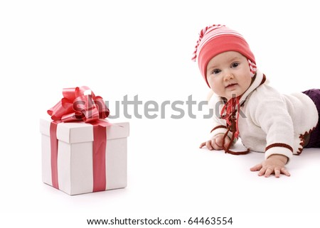 A baby girl and the gift, isolated in white - stock photo