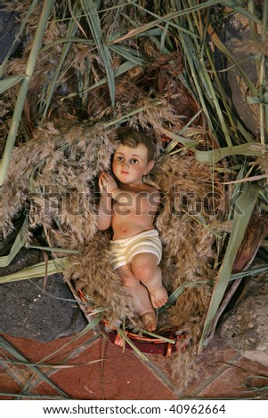 A baby Jesus figure on Christmas, Tabgha-Church of St. Peter's Primacy - stock photo