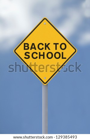 A Back To School road sign against a blue sky background - stock photo