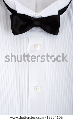 A backgound consisting of a tuxedo shirt with a black silk tie with copy space, formal attire for wedding or waiter or service personell - stock photo