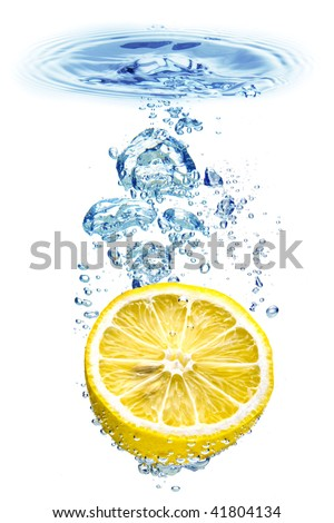 A background of bubbles forming in blue water after lemon is dropped into it. - stock photo