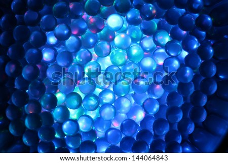 A background of colorful glass marbles. - stock photo