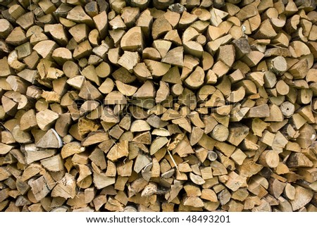 A background of firewood - stock photo