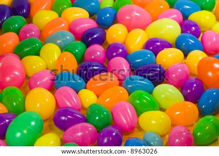 A background of multicolored plastic Easter eggs. - stock photo