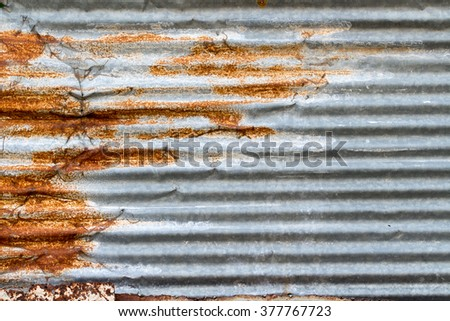 A background of peeling paint and rusty old metal - stock photo
