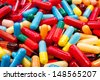 A background of various colorful capsules - stock photo