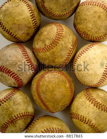 a background of vintage, antique, old baseballs on a white background with copy space - stock photo