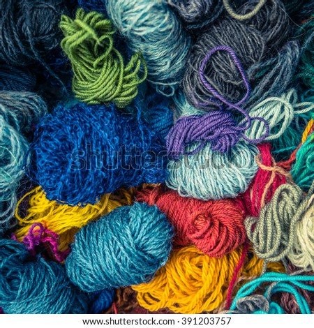 A Background Texture Of Different Types Of Balls Of  Wool - stock photo