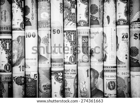 A backgrounds with black and white color of many roll currency from many country - stock photo