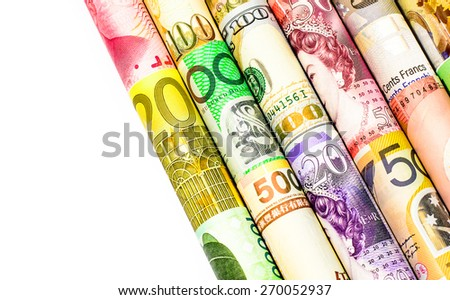 A backgrounds with colorful of many roll currency,money from many country on white background - stock photo