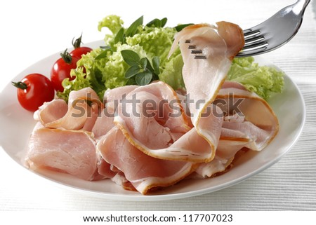 A bacon sliced on fork - stock photo