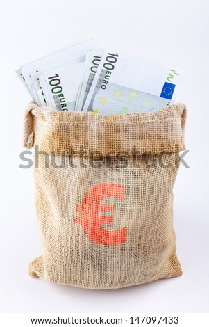 A bag full with 100 euro banknotes with euro sign on the bag isolated on white background - stock photo