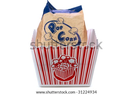 a bag of popped pop corn in a tub isolated on white - stock photo