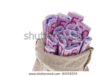 A bag with lots of ? bills. Wealth on a white background. - stock photo