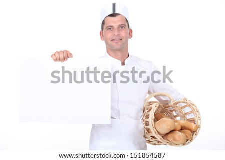 A baker holding a white poster. - stock photo