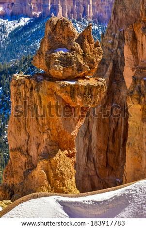 A balancing hoodoo in the snow at Bryce Canyon - stock photo