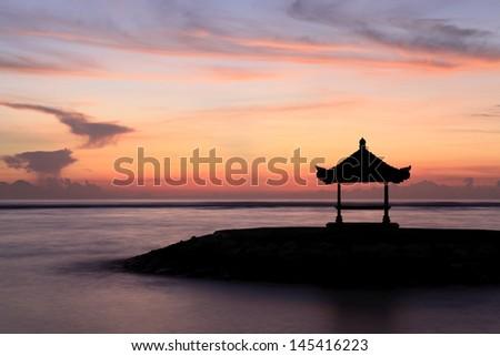 A Balinese Pagoda on the beach at Sanur. Taken at dawn. Bali, Indonesia - stock photo