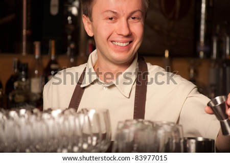 A barman at work - indoors - stock photo