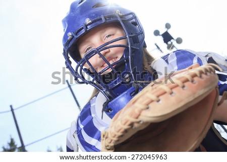 A baseball catcher at the sun light - stock photo