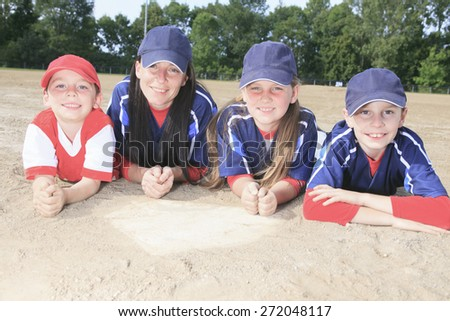 A Baseball team lay on the ground - stock photo
