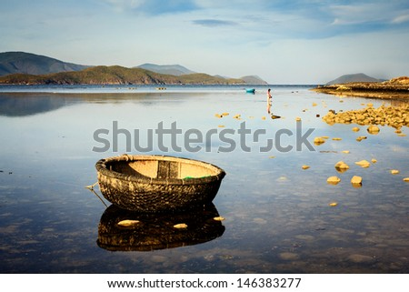 A basket boat on a lagoon in Song Lo, Phuoc Dong, Khanh Hoa, Vietnam. The lagoon is near the Diamond Bay resort, Khanh Hoa. - stock photo