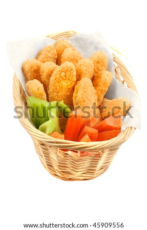 A basket of crispy chicken fingers with vegetables on a white background - stock photo