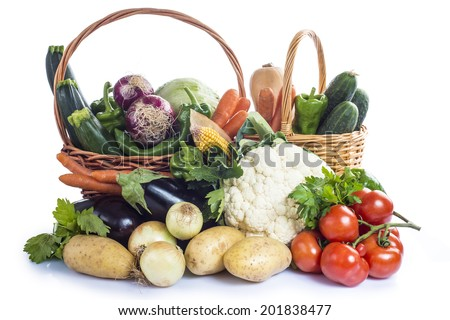 A basket with assortment of vegetables isolated on a white background - stock photo
