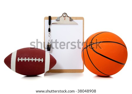 a basketball and American football with coach's clipboard with whistle and white copy space - stock photo
