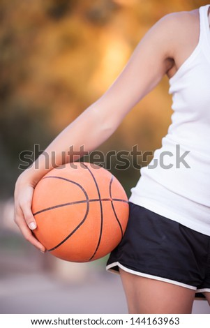 a basketball in his hands, a healthy lifestyle - stock photo