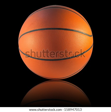 A Basketball or Basket ball isolated on the black background - stock photo