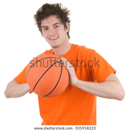 A basketball player holding an orange basketball, isolated on white - stock photo