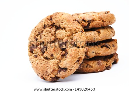 A batch of chocolate chip cookies on white background. - stock photo