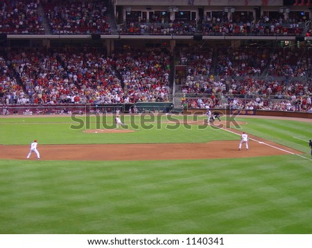 A batter strikes out at a Cincinnati Reds game - stock photo