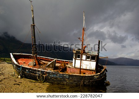 A beached fisherman's ship, Scotland - stock photo