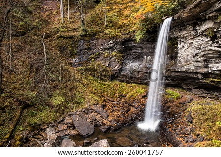 A beautifful slender waterfall in West Virginia  during autumnl colors. This plunge type waterfall looks it's best with peak autumn colors in the trees.  - stock photo