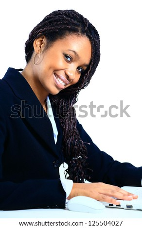 A beautiful african american business woman at work - stock photo