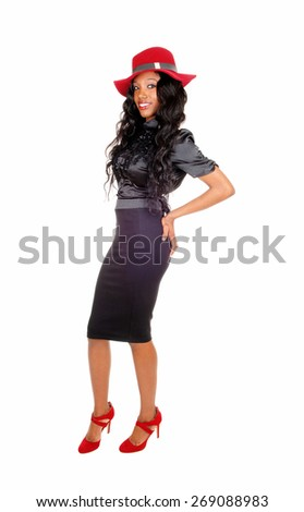 A beautiful African American woman in a black skirt and blouse with a
